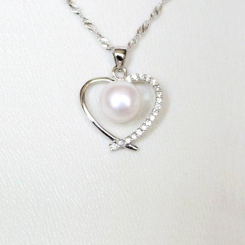 Pendentif - Coeur en argent et perle de culture blanche.